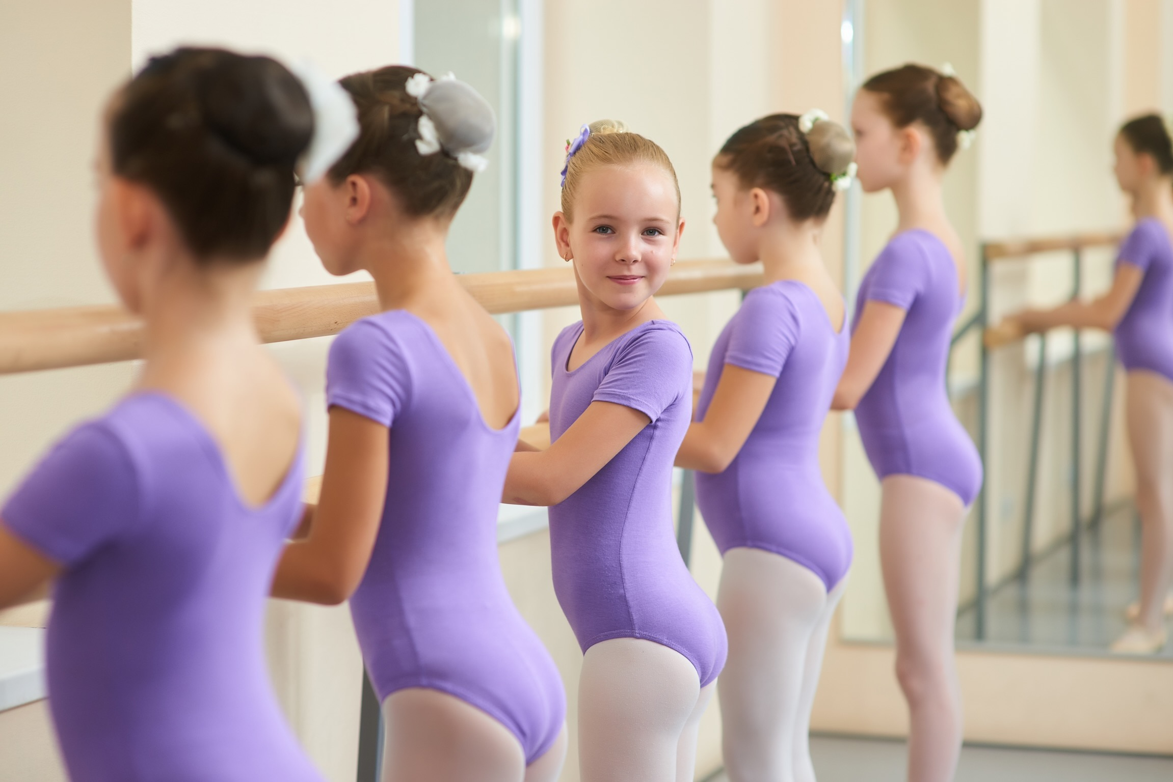 cute grils on dance classes with training leotards