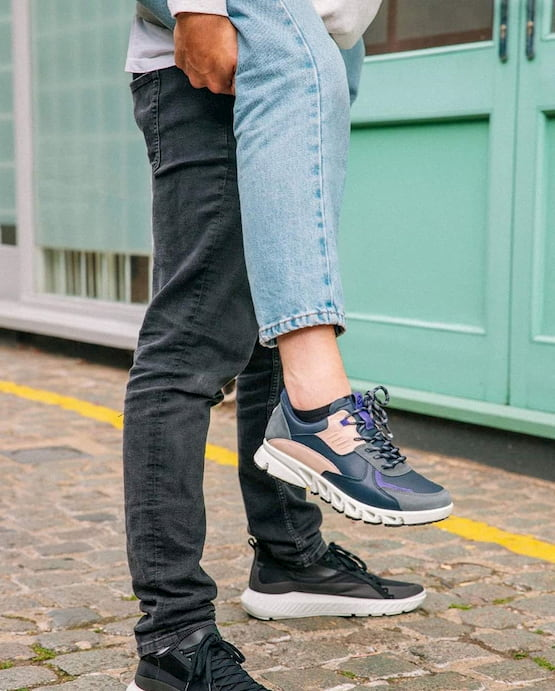 couple wearing ecco sneakers