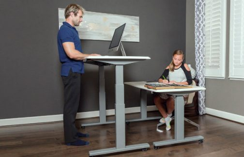father and daughter height adjustable standing desk