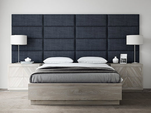 black headboard with white pillow and side lamps and modern blankets on bed