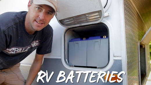 man standing in front of the RV batteries