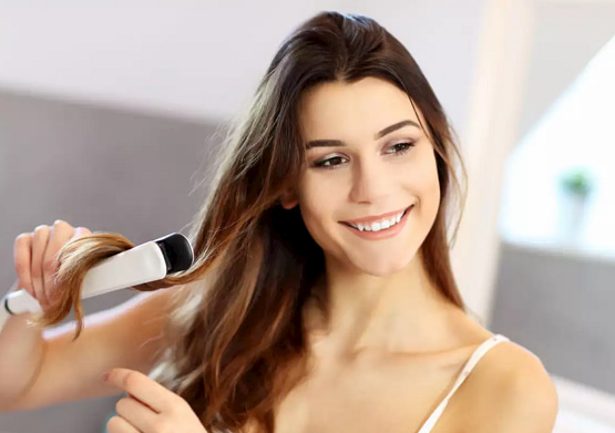 making-hairstyle-with-hair-straightener
