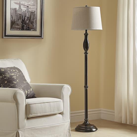 traditional lamp near armchair