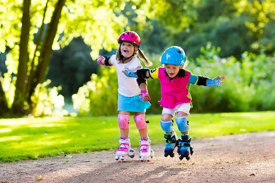 picture of two kids driving roller skates in the park