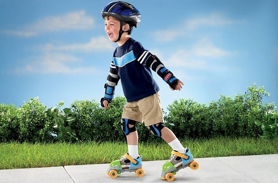 picture of a kid riding adjustable roller skates beside the road