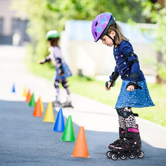 picture of kids riding roller blades on a parking lot