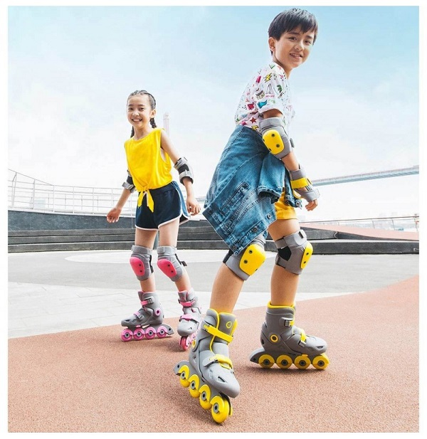 picture of two kids riding roller skates