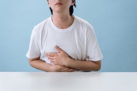 picture of a person with a stomach pain