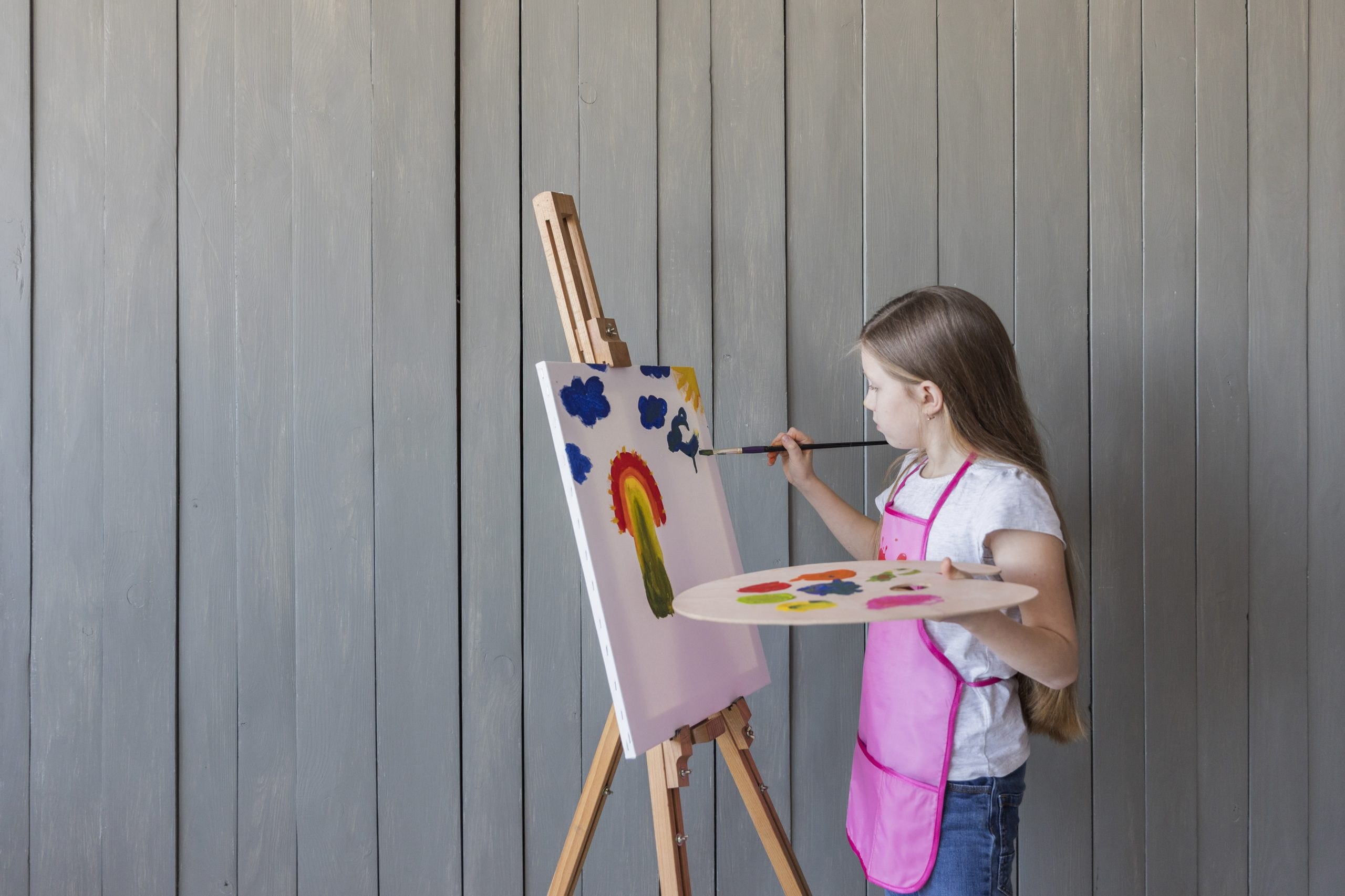 blonde-girl-painting-with-paint-brush
