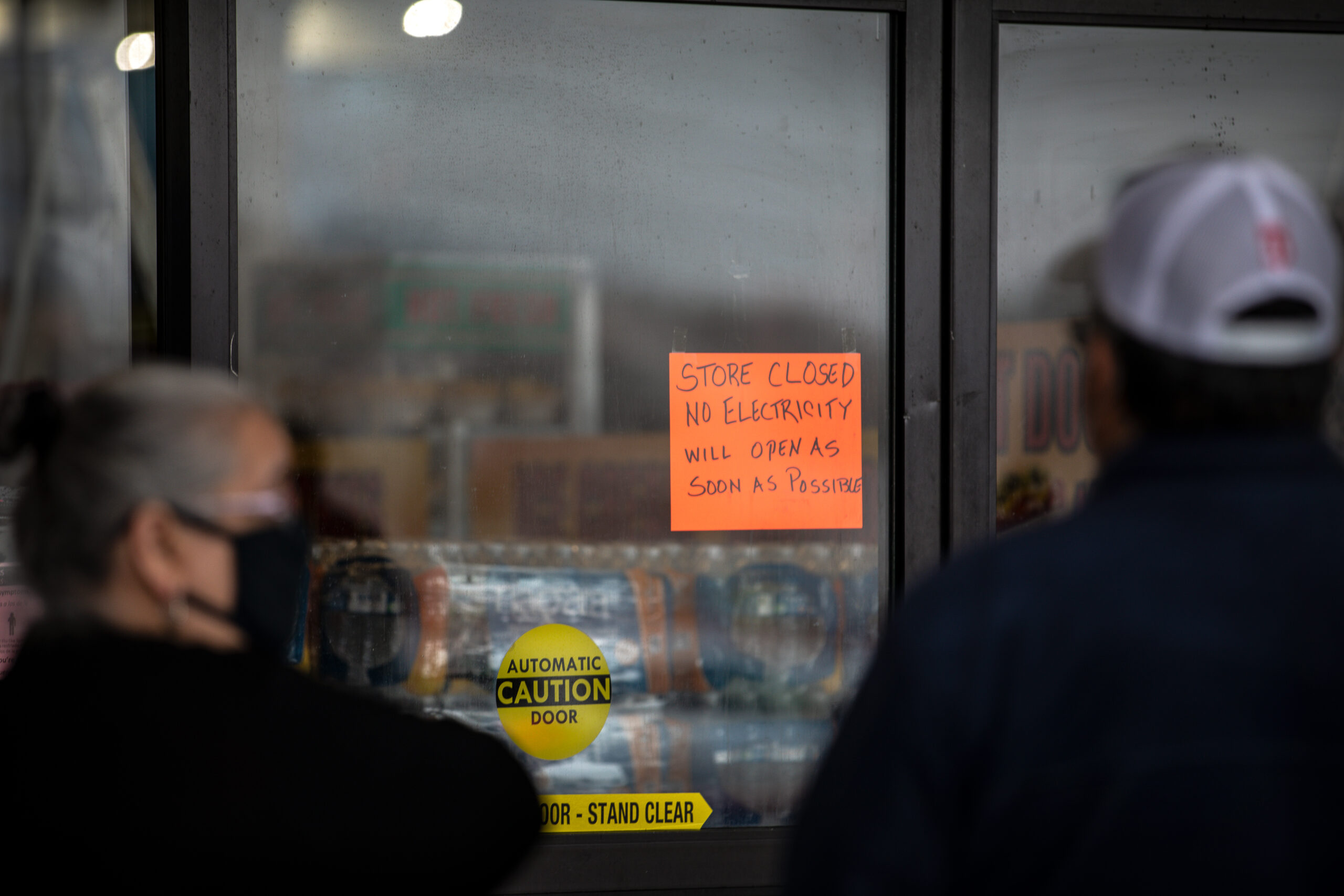 People wait in line for Fiesta Mart to open after the store lost electricity in Austin, Texas.