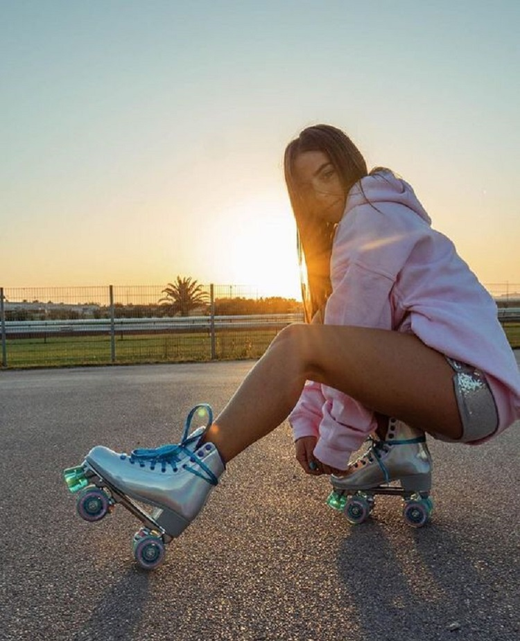 picture of a girl riding impala roller skates on the road