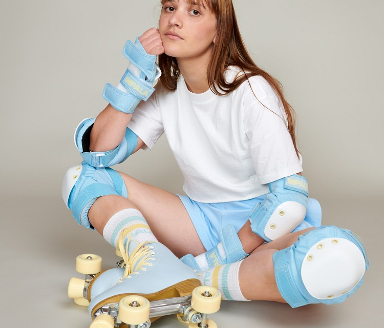 picture of a girl in an impala roller skates and a safe guard